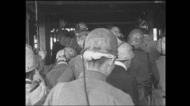 Miners get on an elevator to go down in the Chikuho Coal Mine in Japan.