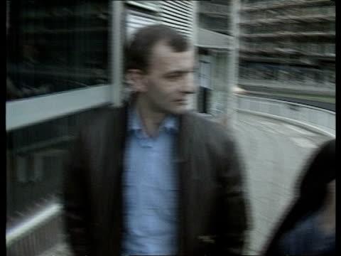 Miners riots ITN Sheffield BACKWARDS as Tony Watson Jim Coglon towards PAN LR MS Men walking RL up street