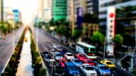 Miniature city, traffic on the road (tilt shift effect)