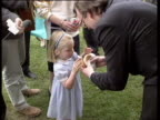 Minister of Agriculture John Selwyn Gummer tries to force feed a burger to his daughter to prove British beef is safe she refuses so he eats it...