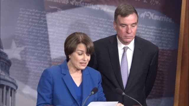 Minnesota Senator Amy Klobuchar begins a news conference with Virginia Senator Mark Warner to discuss legislation introduced to require transparency...