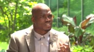 Minnesota Vikings running back Adrian Peterson talks to a WGNTV reporter while visiting Chicago to promote his allergy educational program called...