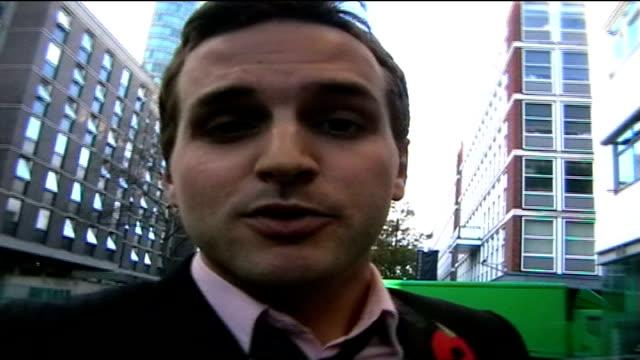 London Reporter to camera SPEEDED UP shot as entering building / door opened and 'Miss Piggy' heard saying SOT 'Go Away' and door slammed shut