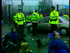 Missile defence system warning LIB Faslane Nuclear Submarine Base AntiNuclear protestors linking arms outside base as held back by police TGV...