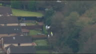 body found Aerials of police at scene SCOTLAND Fife Kirkcaldy of forensic officers and police officers searching woodland behind bungalow where...