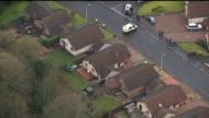 body found / neighbours attend church service AIR VIEW AERIAL of cordonned off bungalow and woodland behind