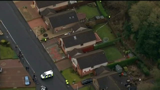 body found / neighbours attend church service Fife Kirkcaldy AIR VIEW AERIAL of cordonned off bungalow and woodland behind