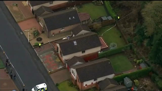 body found / neighbours attend church service 17114 AIR VIEWS / AERIALS of cordonned off bungalow in Dunvegan Avenue
