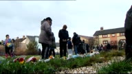 body found / neighbours attend church service SCOTLAND Edinburgh Local people looking at floral and other tributes left in memory of Mikaeel Kular...