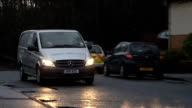 body found / neighbours attend church service Private ambulance along