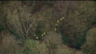 body found / neighbours attend church service Kirkcaldy Police officers in woodland area