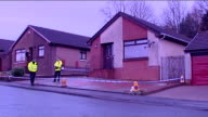 GVs Kirkcaldy bungalow SCOTLAND Fife Kirkcaldy EXT General views of cordonedoff bungalow and police on duty / BV Police along road / cordonned off...