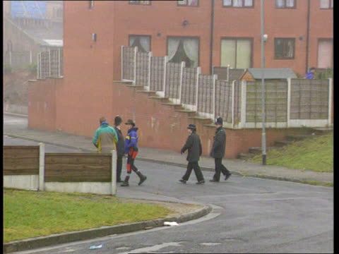Police step up search ENGLAND TBV TRACK FORWARD behind men's legs TILT UP Lancs as two members of local mountain rescue unit Oldham away along road...