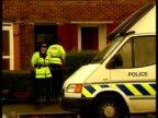 Police hunt ENGLAND Warrington EXT Police officers standing guard outside family home MS Bicycle belonging to Charlotte in alleyway at side of house...