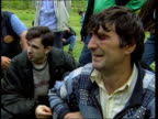 Missing Kosovar Albanian men released from jail by Serb forces ALBANIA Border with Kosovo Reporter to camera DAY Kosovar Albanian refugee men...