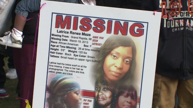 Missing posters at a vigil for missing woman Latrice Maze in Grand Rapids Michigan on April 11 2013