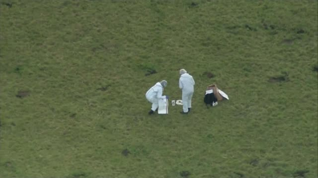 man arrested on suspicion of murder ENGLAND Dorset Swanage VIEW / AERIAL forensic police officers in field AIR VIEW coast near Swanage AIR VIEW...