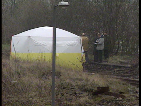 Liverpool Walton LMS Site where body found ZOOM IN cover over site beside railway line MS Police standing talking by cover LMS Railway line and...