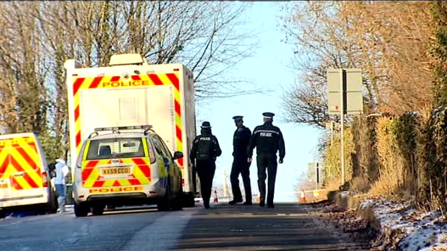 police find body general views police at scene ENGLAND North Somerset Failand Team of police officers towards up road / Forensics officer / Police...