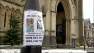 police search / church vigil / rescue team EXT 'Jo Yeates Missing' poster on lamp post outside church / Shots of parked ambulance and rescue team...
