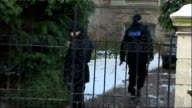 police search / church vigil / rescue team ENGLAND Bristol Team of police officers along with tools outside house / Various shots officers along with...
