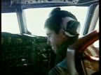 Missing yachtsman rescued INT Aircrew of Australian Air Force Orion rescue plane at controls in cockpit TLS Sea as seen thru plane window Pilot...