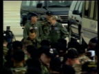 Rumsfeld off coach and along during visit to Whiteman Air Force base TGV Troops assembled beside B2 Stealth bomber on tarmac ZOOM IN