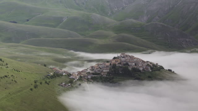 A mist filled Piano Grande in Umbria.
