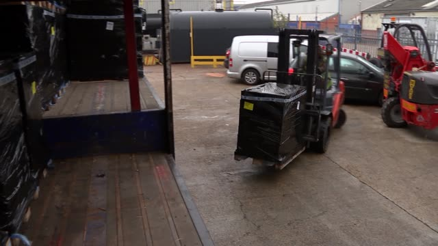 Mixed Freight Services cargo company general views ENGLAND London Heathrow Airport EXT General view man unloading cargo from lorry / Forklift truck...