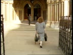 London High Courts White foster mother arrives at court Weiner i/c