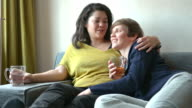 DOLLY: Mixed race lesbian couple at home