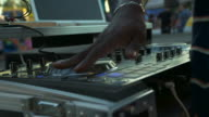 DJ mixing at a large event