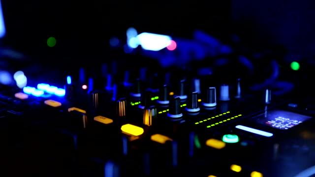DJ mixing music at club closeup.