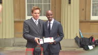 Mo Farah and Ewan McGregor pose at Buckingham Palace with medals goings Investitures at Buckingham Palace at Buckingham Palace on June 28 2013 in...