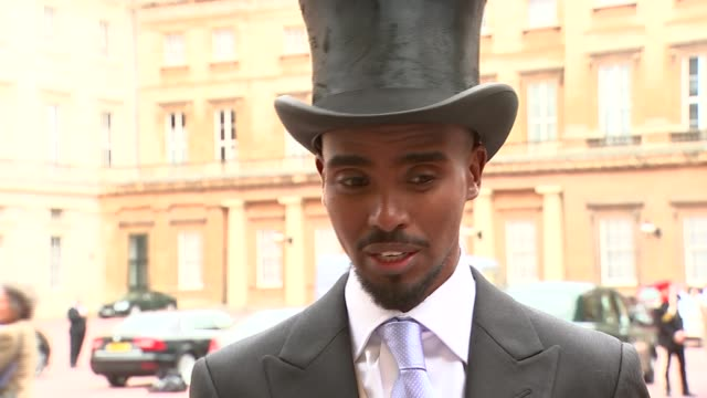 London Buckingham Palace Sir Mo Farah in top hat and tails talking to ITN reporter Sir Mo Farah interview SOT To be given a title like this don't...