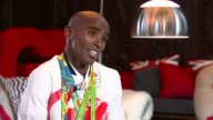 Mo Farah wins 5000m to achieve 'double double' INT Mo Farah interview SOT/ ENGLAND London Hounslow EXT GV Hounslow high street/ Reporter to camera