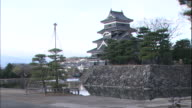 A moat surrounds Matsumoto Castle in Nagano.