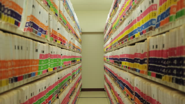Mobile shelves open showing thousands of medical files