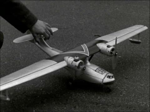 Surrey Kenley EXT LS model aircraft in flight Cadets with models Cadet holds model of Lancaster bomber CS model of flying boat 'Catalina' GV Focke...