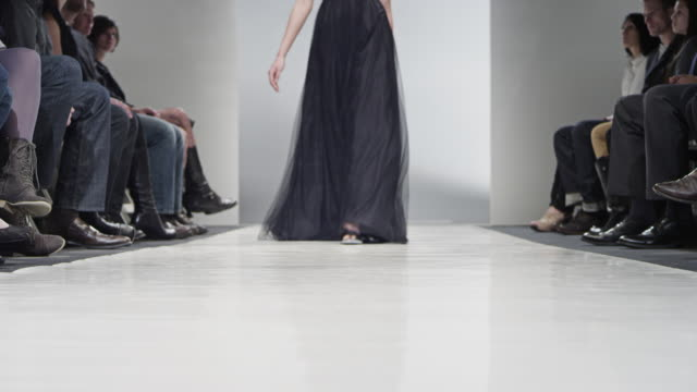 MS LA Model in gown walking down middle of catwalk during fashion show