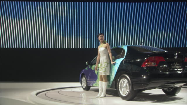 MS Model presenting hybrid car at Beijing Auto Show, Beijing, China