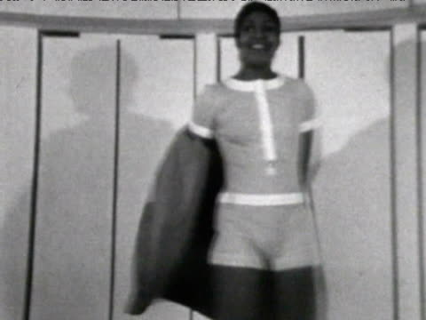 Model removes coat to reveal shorts 1970