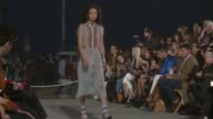 Model walks the runway at TommyLand Tommy Hilfiger Spring 2017 Fashion Show at Venice Beach on February 08 2017 in Venice California