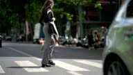 A model wears a black top an Y3 bag striped flared pants outside the Y3 show during Paris Fashion Week Menswear Spring/Summer 2018 on June 25 2017 in...