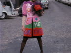 A model wears a brightly coloured Yves St Laurent patchwork wedding dress