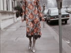 A model wears a floral fringed dress designed by Clive