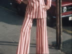 A model wears a Mary Quant tailored pinstripe trouser suit