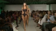 Models and designer walk the runway at LYCRA Presents Lybethras 2016 Collection at SWIMMIAMI Runway at FUNKSHION Tent on July 19 2015 in Miami Florida