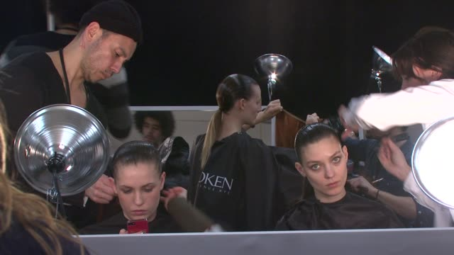Models prepare to walk the runway before CND For Alexander Wang New York Fashion Week Fall/Winter2013 at The Cunard Building on February 09 2013 in...