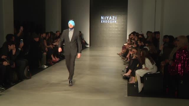 Models present the creations of fashion designer Niyazi Erdogan during Mercedes Benz Fashion Week Istanbul FW15 on March 16 2015 in Istanbul Turkey